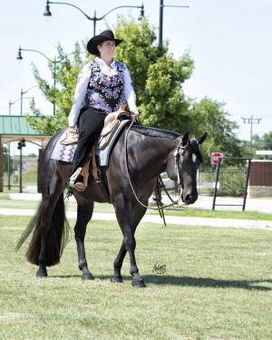 Pictured here is H&J Equine natural horse supplement co-founder, Jeri, with her horse Moonshine.
